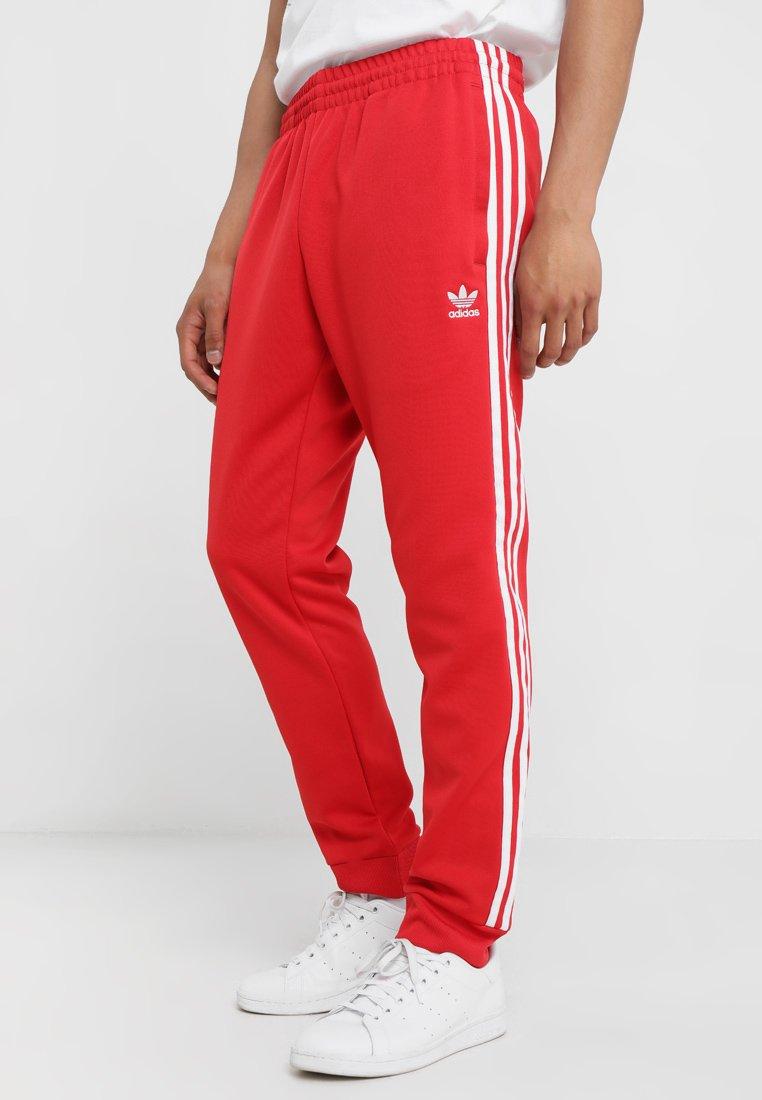 adidas Originals - Tracksuit bottoms - collegiate red