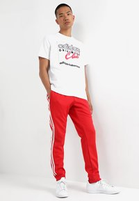 adidas Originals - Pantalon de survêtement - collegiate red