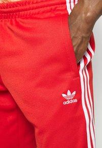 adidas Originals - Jogginghose - red - 4