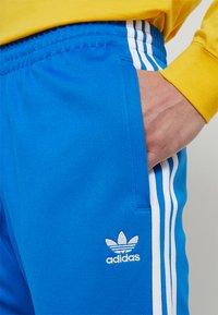adidas Originals - Pantalon de survêtement - bluebird - 4