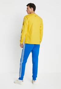 adidas Originals - Pantalon de survêtement - bluebird - 2
