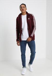 adidas Originals - BECKENBAUER - Training jacket - maroon - 1