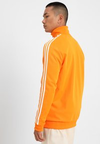 adidas Originals - BECKENBAUER - Training jacket - bright orange - 2