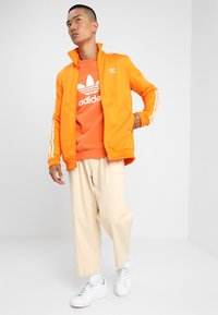 adidas Originals - BECKENBAUER - Training jacket - bright orange - 1