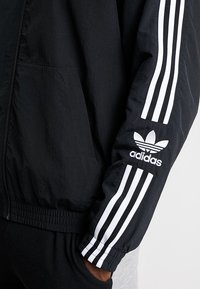 adidas Originals - TRACKTOP - Veste de survêtement - black - 5