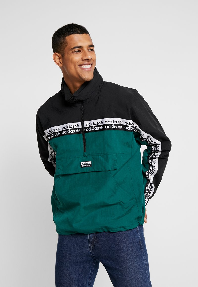 adidas Originals - REVEAL YOUR VOICE WIND  - Cortaviento - collegiate green
