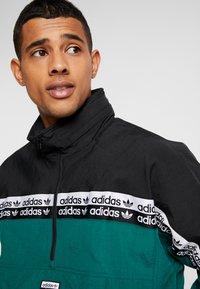 adidas Originals - REVEAL YOUR VOICE WIND  - Windbreaker - collegiate green - 4