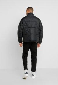 adidas Originals - REVEAL YOUR VOICE JACKET - Vinterjacka - black - 3