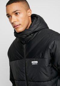 adidas Originals - REVEAL YOUR VOICE JACKET - Winterjas - black - 4