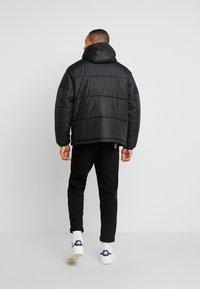 adidas Originals - REVEAL YOUR VOICE JACKET - Winterjas - black - 2