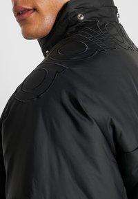 adidas Originals - REVEAL YOUR VOICE JACKET - Vinterjacka - black - 5