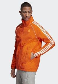 adidas Originals - SST WINDBREAKER - Giacca sportiva - orange - 2