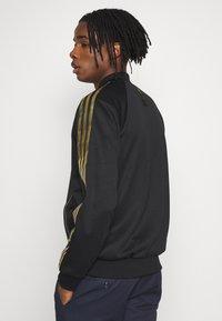 adidas Originals - SUPERSTAR SPORT INSPIRED TRACK TOP - Veste de survêtement - black/gold - 2