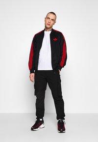 adidas Originals - SUPERSTAR SPORT INSPIRED TRACK TOP - Giacca sportiva - black/red - 1