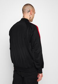 adidas Originals - SUPERSTAR SPORT INSPIRED TRACK TOP - Giacca sportiva - black/red - 2