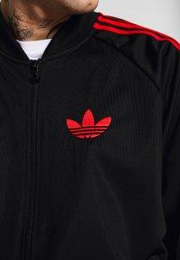 adidas Originals - SUPERSTAR SPORT INSPIRED TRACK TOP - Giacca sportiva - black/red - 5