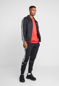 adidas Originals - LOCK UP ADICOLOR SPORT INSPIRED TRACK TOP - Trainingsjacke - black - 1