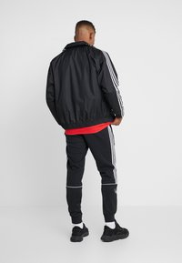 adidas Originals - LOCK UP ADICOLOR SPORT INSPIRED TRACK TOP - Trainingsjacke - black - 2