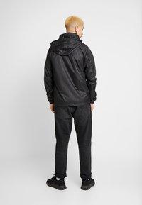 adidas Originals - GRAPHICS SPORT INSPIRED JACKET - Větrovka - black - 2