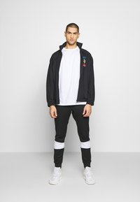 adidas Originals - Training jacket - black - 1