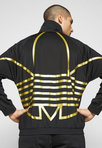 adidas Originals - Training jacket - black - 6