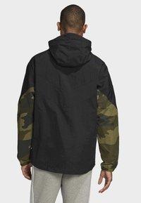 adidas Originals - CAMOUFLAGE WINDBREAKER - Tunn jacka - black - 1