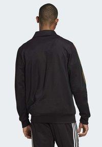 adidas Originals - CAMOUFLAGE TRACK TOP - Training jacket - black - 1