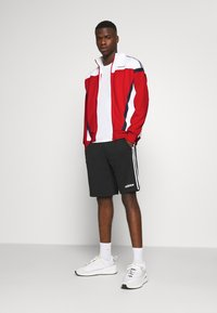 adidas Originals - CLASSICS  - Kurtka sportowa - scarle/white - 1