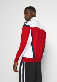 adidas Originals - CLASSICS  - Kurtka sportowa - scarle/white - 2