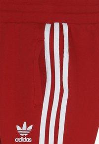 adidas Originals - TREFOIL PANTS - Verryttelyhousut - red - 2