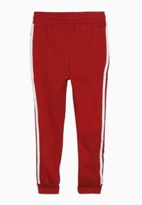 adidas Originals - TREFOIL PANTS - Verryttelyhousut - red - 1