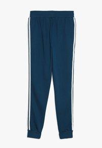adidas Originals - TREFOIL PANTS - Verryttelyhousut - legend marine/white - 1