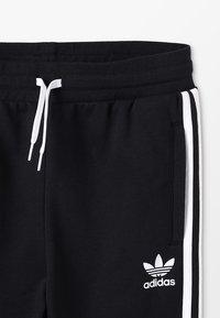 adidas Originals - TREFOIL PANTS - Verryttelyhousut - black/white - 2