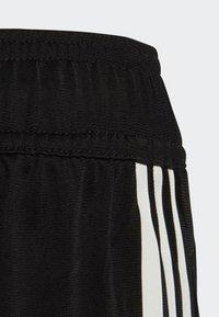 adidas Originals - FLAMESTRIKE TRACKSUIT BOTTOMS - Pantalon de survêtement - black - 3