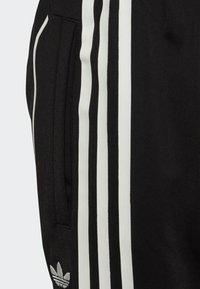 adidas Originals - FLAMESTRIKE TRACKSUIT BOTTOMS - Pantalon de survêtement - black - 4