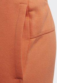 adidas Originals - JOGGERS - Tracksuit bottoms - orange - 6