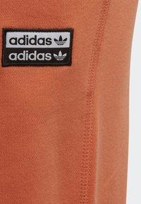 adidas Originals - JOGGERS - Tracksuit bottoms - orange - 2