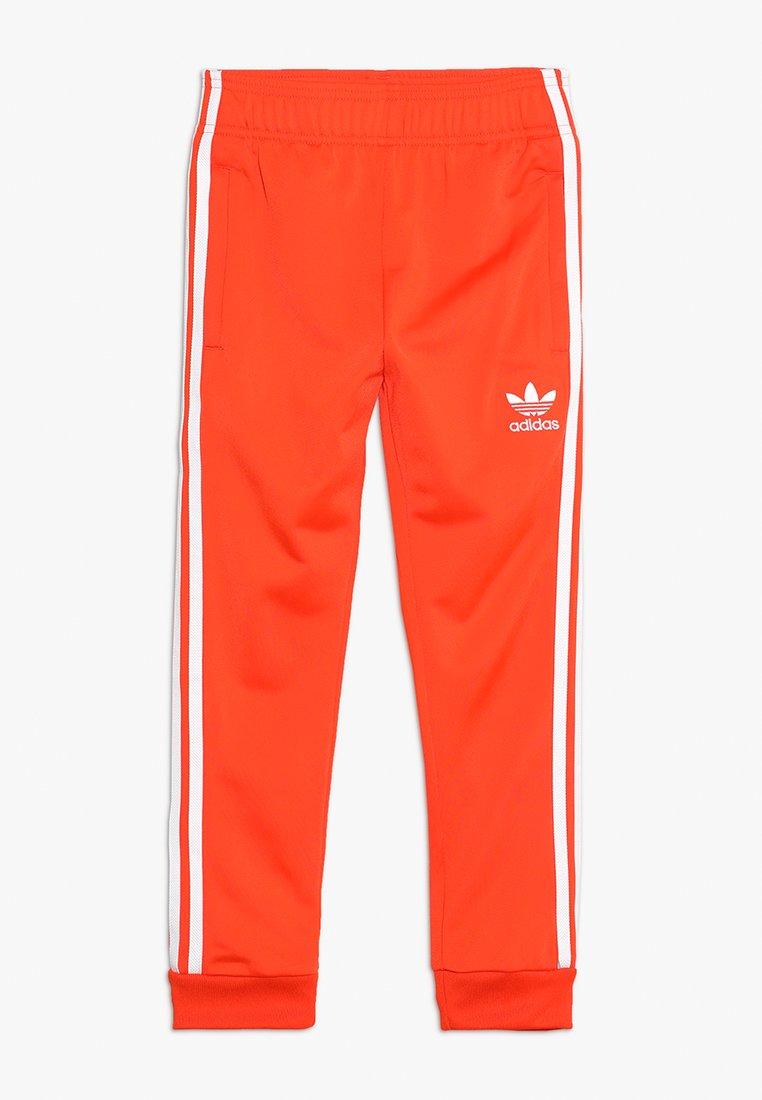 adidas Originals - SUPERSTAR PANTS - Jogginghose - active orange/white