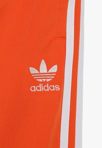 adidas Originals - SUPERSTAR PANTS - Pantaloni sportivi - orange/white - 4