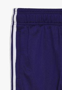 adidas Originals - SUPERSTAR PANTS - Teplákové kalhoty - purple/white - 2