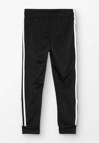 adidas Originals - SUPERSTAR PANTS - Pantalones deportivos - black/white - 1