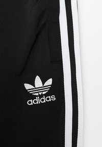 adidas Originals - SUPERSTAR PANTS - Pantaloni sportivi - black/white - 4