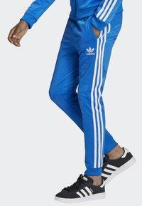 adidas Originals - SST TRACKSUIT BOTTOMS - Verryttelyhousut - blue/white - 3