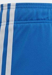 adidas Originals - SST TRACKSUIT BOTTOMS - Verryttelyhousut - blue/white - 5