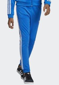 adidas Originals - SST TRACKSUIT BOTTOMS - Verryttelyhousut - blue/white - 4