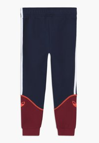 adidas Originals - OUTLINE PANTS - Tracksuit bottoms - dark blue - 1