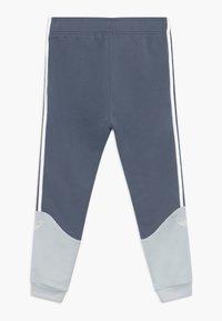 adidas Originals - Tracksuit bottoms - blue - 1