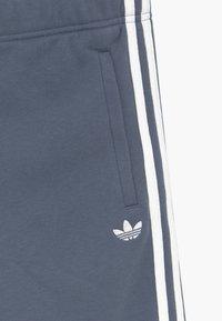 adidas Originals - Tracksuit bottoms - blue - 3