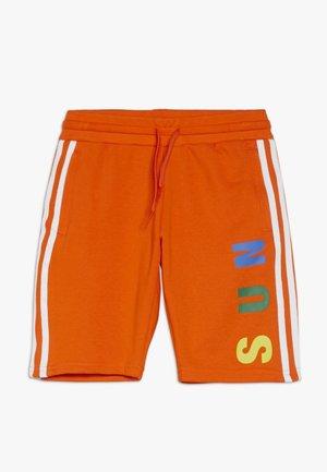 PHARRELL WILLIAMS  - Shorts - orange
