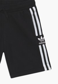 adidas Originals - LOCK UP - Tracksuit bottoms - black/white - 3